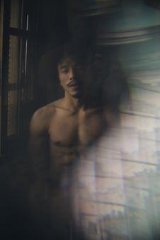 Free Topless Man Standing Beside Window Stock Image - 136346521
