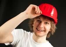 Free Smiling Young Man In A Hard Hat Royalty Free Stock Photos - 13642788