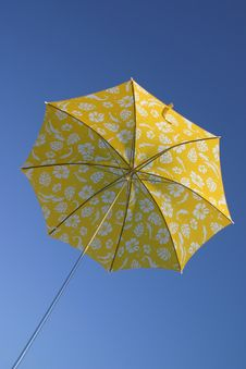 Yellow Umbrella In Blue Sky Royalty Free Stock Images