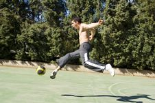 Free Young Man Kicking Ball Stock Photography - 13644392