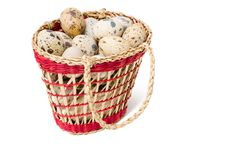 Quail Eggs In A Straw Basket Stock Photography