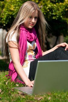 Free A Blond Girl With A Laptop Royalty Free Stock Photo - 13649105