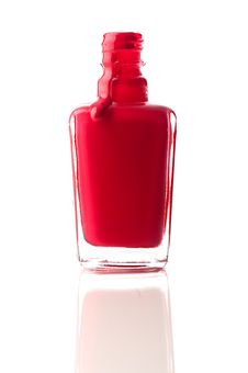 Red Nail Polish Running Out Of A Container Stock Photography