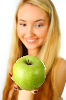 Woman With Green Apple. Stock Photography