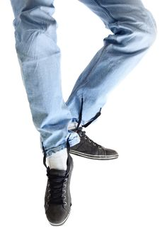 Legs In Jeans And Dirty Sneakers Royalty Free Stock Photography