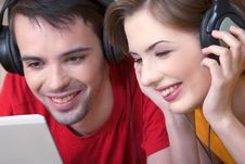 Free Young  Couple With Musical Ear-phones Stock Photo - 13650050
