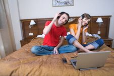 Free Young  Couple With Musical Ear-phones Royalty Free Stock Images - 13650069
