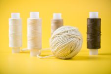 Ball Of Yarn And Spools Of Thread Stock Image