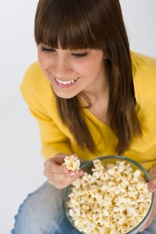 Free Smiling Female Teenager With Popcorn Royalty Free Stock Photo - 13652035