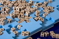 Blue Puzzle With  Wood Letter Royalty Free Stock Photography