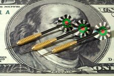 Dollar And Darts Stock Image