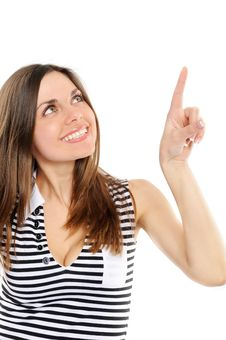 Happy Young Woman Pointing At Copy Space Stock Image