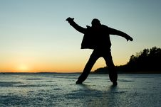 Free Silhouette Of A Man Glidin On Ice Royalty Free Stock Image - 13655486