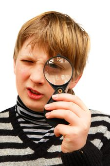 A Boy And A Magnifying Glass Stock Image