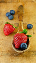 Free Fresh Strawberries And Blueberries In Wooden Spoon Royalty Free Stock Image - 13661906