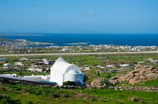 The White Buildings And Churches On The Mykonos. Stock Photo