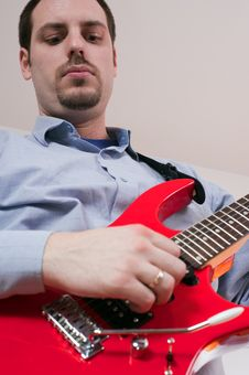 Free Man Playing A Red Electric Guitar Stock Photos - 13661303