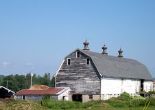 Old Barn With Three Spinners Royalty Free Stock Images