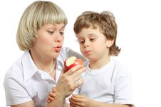 Free Woman And Boy Eating Apple Stock Photos - 13661743