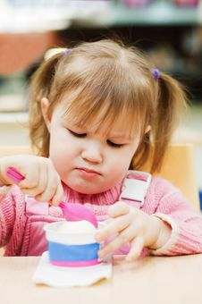 Girl Eats Ice-cream Royalty Free Stock Photo