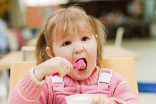 Girl Eats Ice-cream Stock Photo