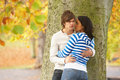 Free Romantic Teenage Couple By Tree In Autumn Park Royalty Free Stock Image - 13671466