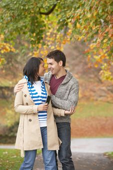Free Romantic Teenage Couple In Autumn Park Stock Images - 13671834