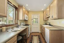 Free Kitchen With Oak Wood Cabinetry Stock Photography - 13672462