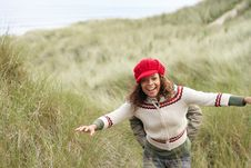 Free Teenage Girl Walking Through Sand Dunes Royalty Free Stock Photography - 13672497