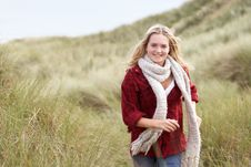 Teenage Girl Walking Through Sand Dunes Royalty Free Stock Photo