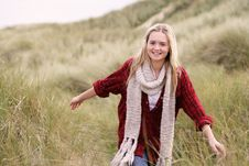 Teenage Girl Walking Through Sand Dunes Royalty Free Stock Photos