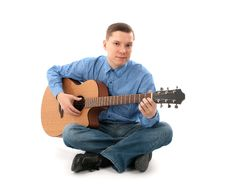 Man With Acoustic Guitar Royalty Free Stock Image