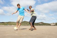Free Two Young Men Palying Football On Beach Together Royalty Free Stock Photography - 13673467