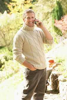 Free Man Outdoors On Mobile Phone In Garden Royalty Free Stock Photography - 13673897