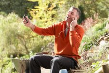Free Man Outdoors Listening To MP3 Player Stock Photo - 13674060