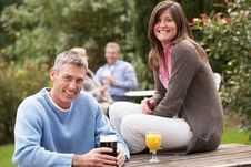 Free Couple Enjoying Drink In Pub Garden Stock Images - 13674064