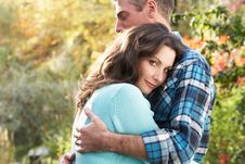 Free Romantic Couple Embracing By Woodland Stock Photography - 13674532