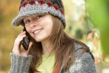 Free Young Girl Outside Using Mobile Stock Image - 13674961