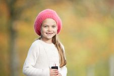 Young Girl Outdoors With MP3 Player Royalty Free Stock Photography