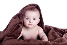 Free A Beautiful Baby Under A Brown Towel Royalty Free Stock Photos - 13675938
