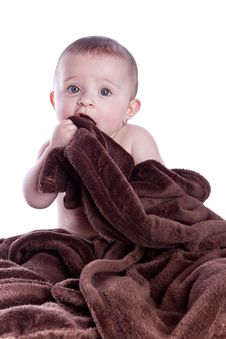 Free A Beautiful Baby Under A Brown Towel Stock Photography - 13675972