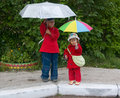 Free Children With Umbrellas Royalty Free Stock Image - 13683706