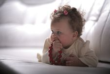 Free Baby Girl With Red Beads In Profile Stock Images - 13680554