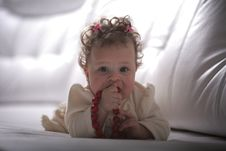 Free Baby Girl With Red Beads Royalty Free Stock Photo - 13680565