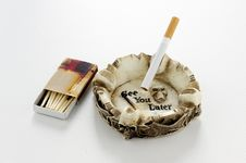 Cigarette In Skull Ashtray With Matches