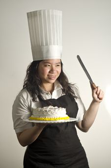 Free Baker Preparing To Cut A Cake Stock Images - 13683094