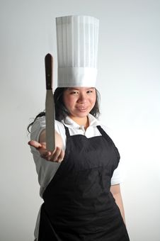 Free Asian Chef Balancing Her Knife By Her Fingertips Royalty Free Stock Images - 13683149