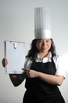 Chef Showing You Her Checklist Before Cooking Stock Images