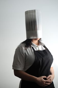 Chef Embarassed With Her Cooking Royalty Free Stock Image
