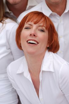Red Haired Woman Wearing White Shirt Stock Photo